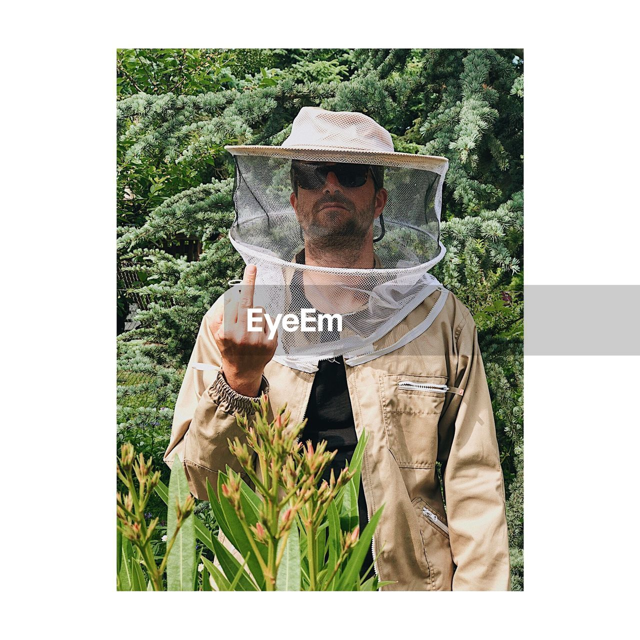 one person, front view, transfer print, plant, real people, men, standing, waist up, adult, day, holding, males, growth, land, portrait, auto post production filter, field, lifestyles, nature, outdoors, mature men, farmer, digital composite