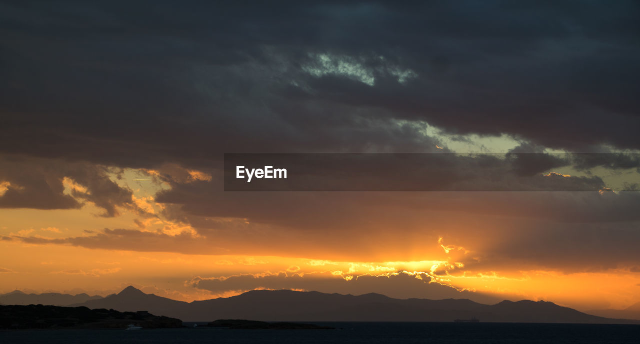sky, sunset, cloud - sky, beauty in nature, scenics - nature, tranquility, tranquil scene, orange color, mountain, idyllic, silhouette, nature, water, no people, dramatic sky, non-urban scene, sea, mountain range, outdoors