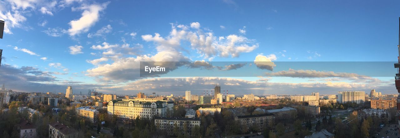 Panoramic View Of Cityscape Against Blue Sky