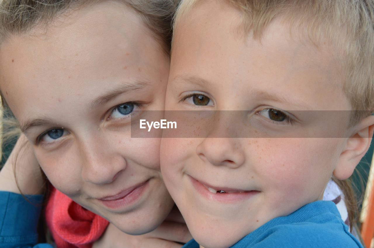 Close-up portrait of cute siblings