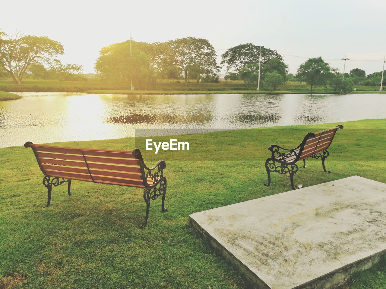 seat, plant, lake, grass, nature, chair, water, tree, table, empty, absence, no people, bench, day, tranquility, beauty in nature, lawn, green color, outdoors, park bench