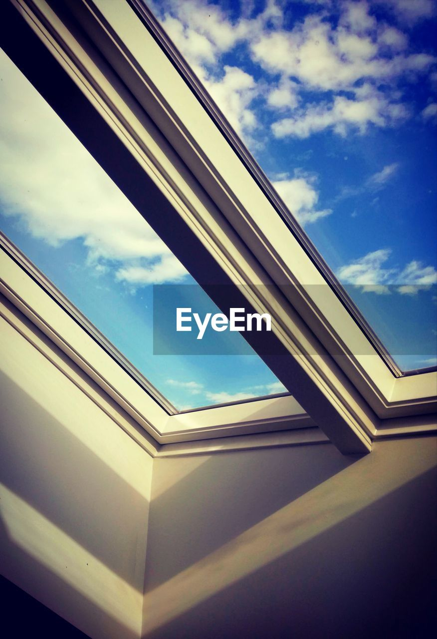 cloud - sky, sky, low angle view, built structure, architecture, window, no people, day, glass - material, nature, building exterior, transparent, outdoors, building, corner, reflection, sunlight, geometric shape, close-up, directly below, window frame