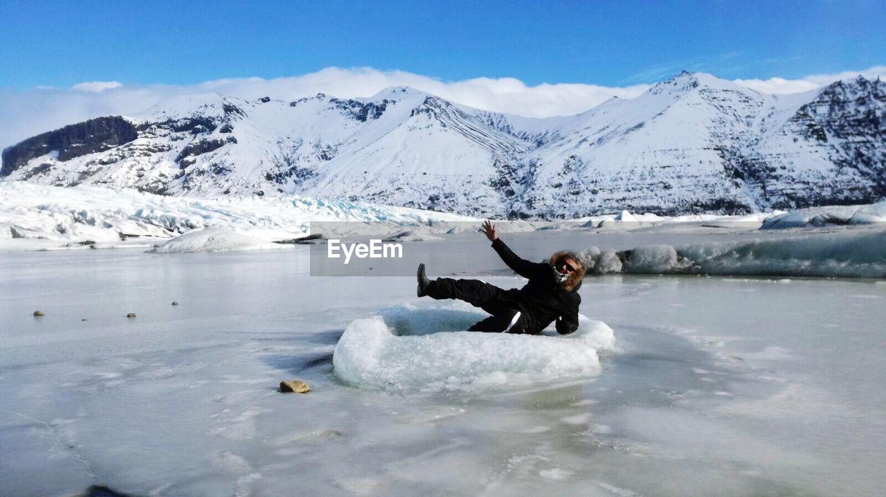 Man On Frozen Landscape Against Sky