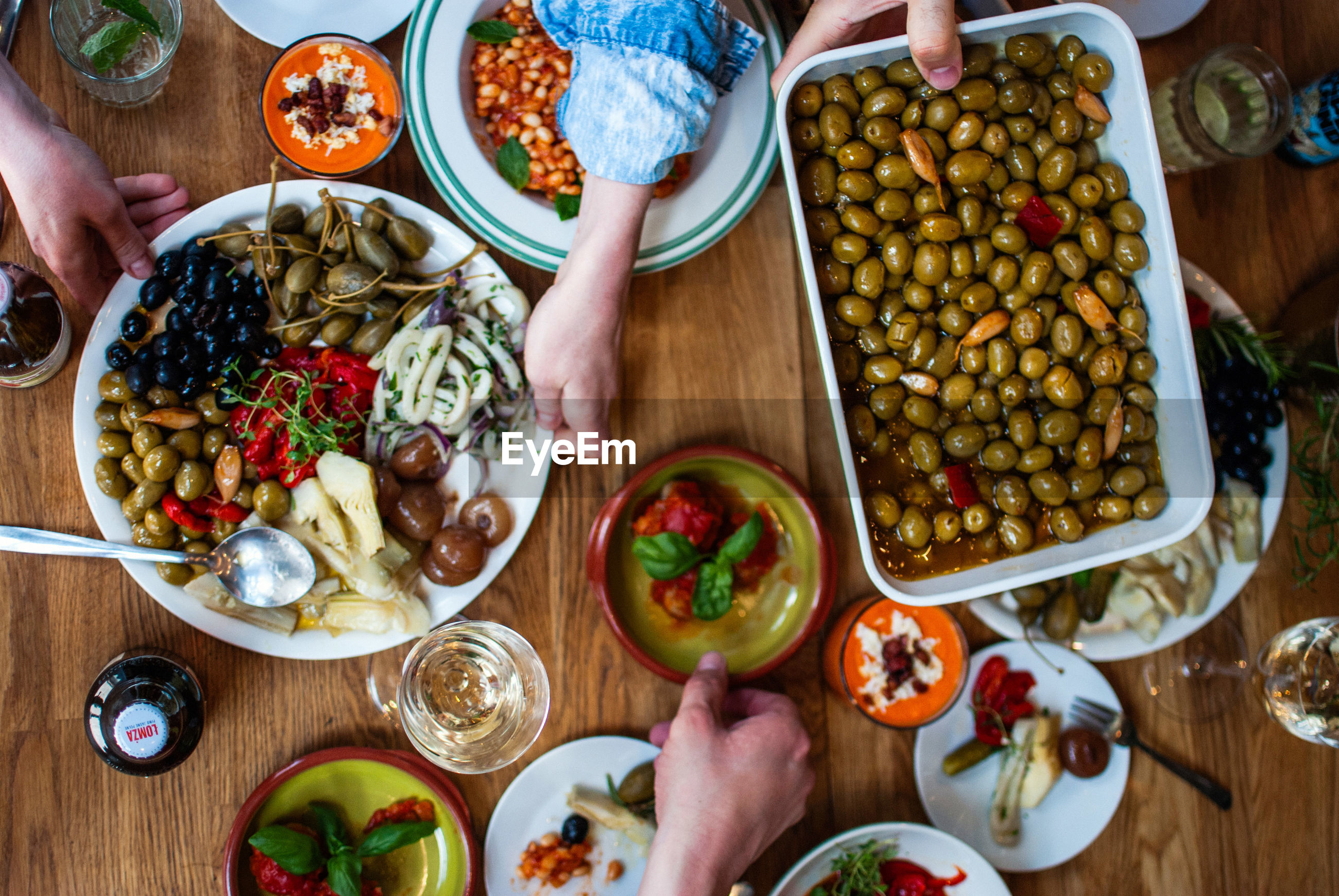 Cropped image of hands with food served on table