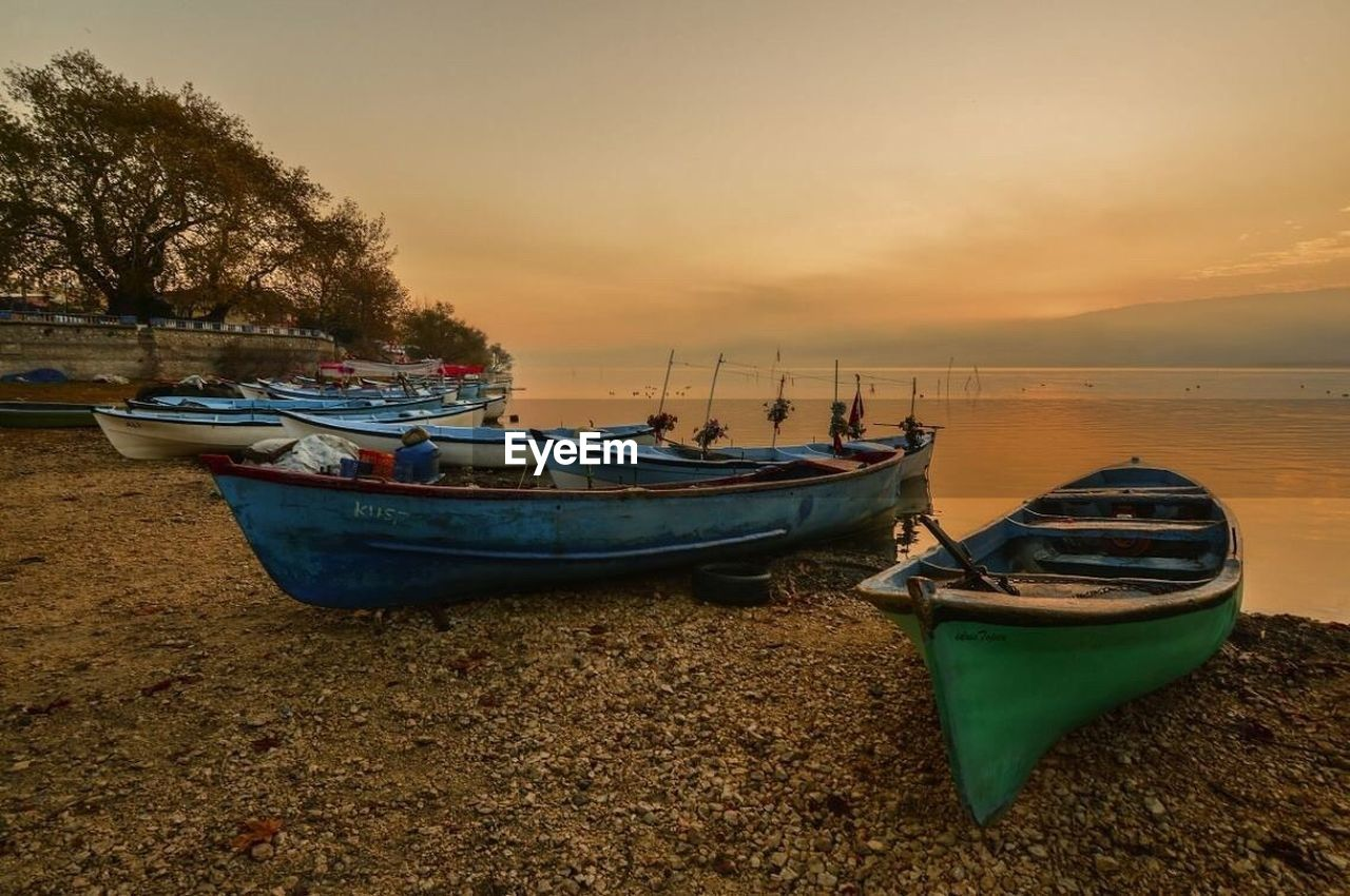 nautical vessel, moored, transportation, mode of transport, boat, water, nature, sunset, tranquility, reflection, no people, sky, tranquil scene, sea, beauty in nature, scenics, outdoors, rowboat, beach, tree, clear sky, day