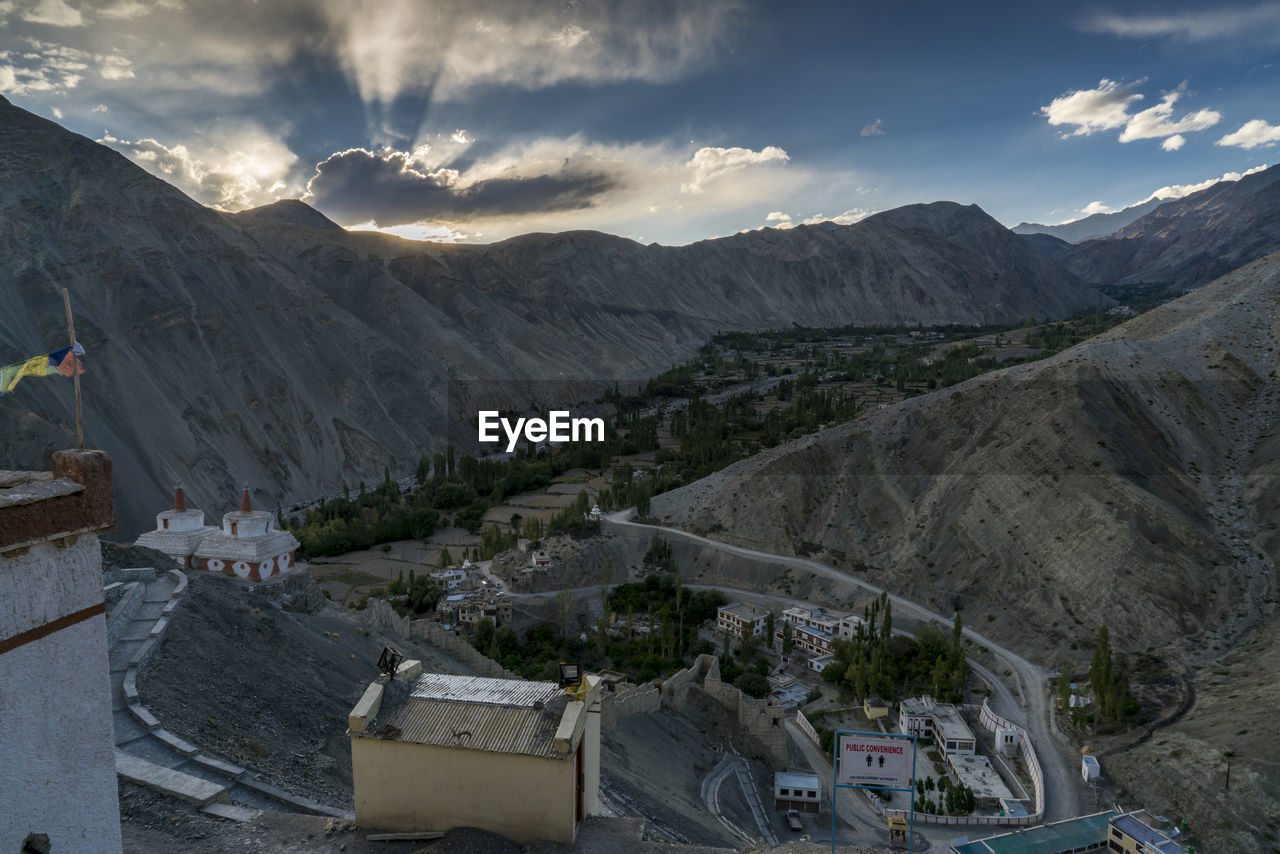 mountain, sky, cloud - sky, mountain range, scenics - nature, environment, nature, beauty in nature, architecture, built structure, no people, day, high angle view, landscape, building exterior, non-urban scene, outdoors, building, town