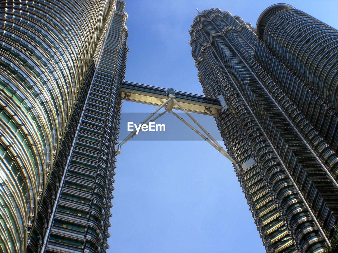 low angle view, architecture, built structure, building exterior, sky, outdoors, day, no people, skyscraper