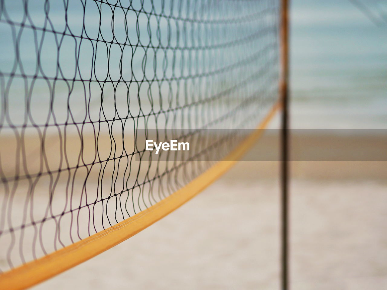 Close-up of net at beach