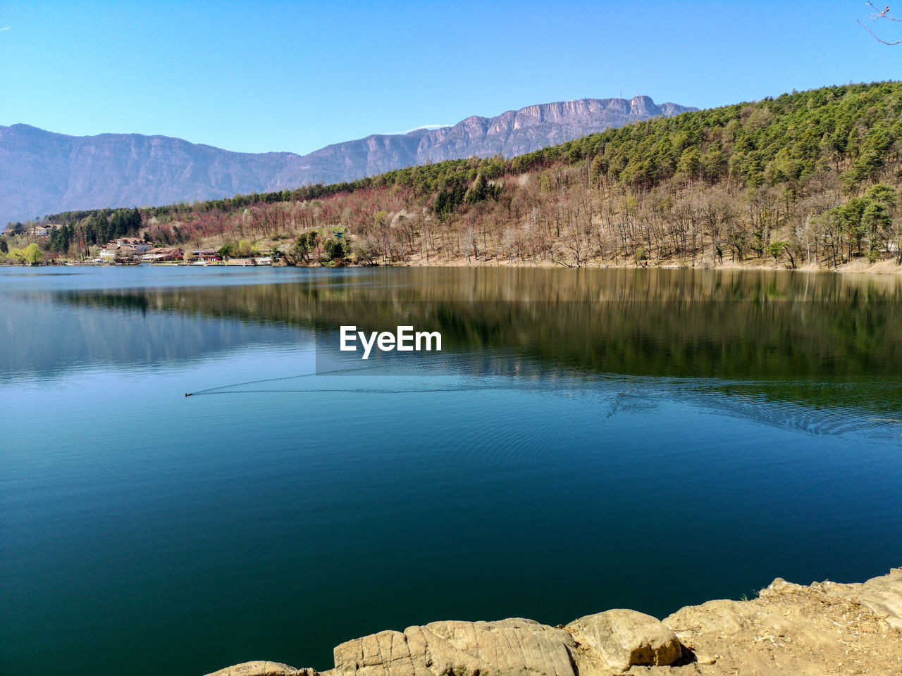 water, mountain, scenics - nature, lake, beauty in nature, reflection, tranquil scene, sky, tranquility, day, nature, waterfront, blue, tree, mountain range, clear sky, plant, no people, idyllic, outdoors