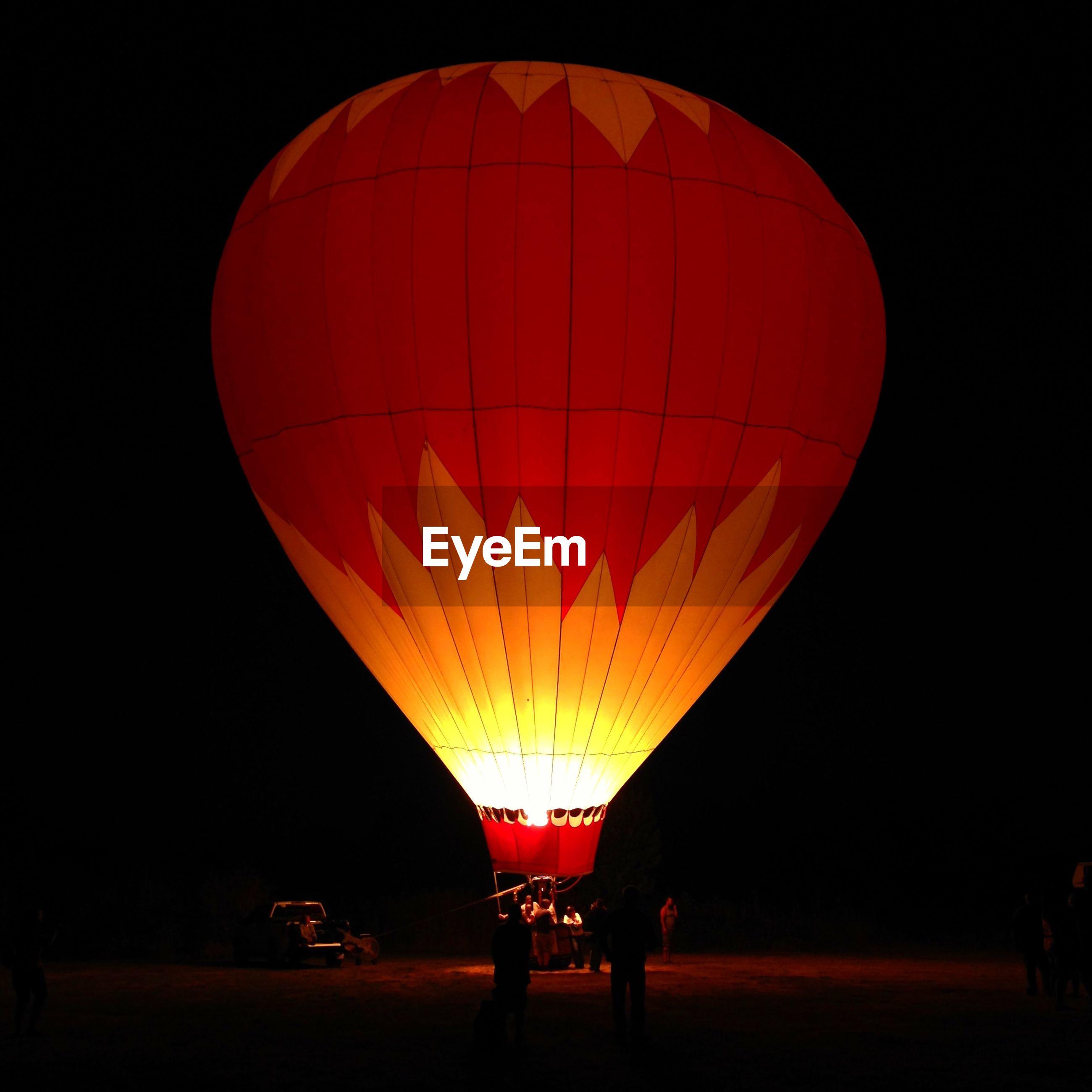 Illuminated hot air balloon at night