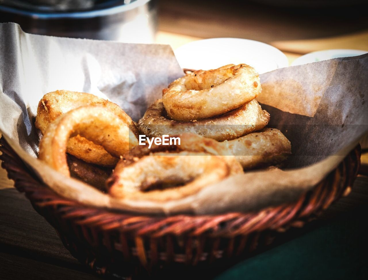 Close-Up Of Onion Rings In Basket On Table