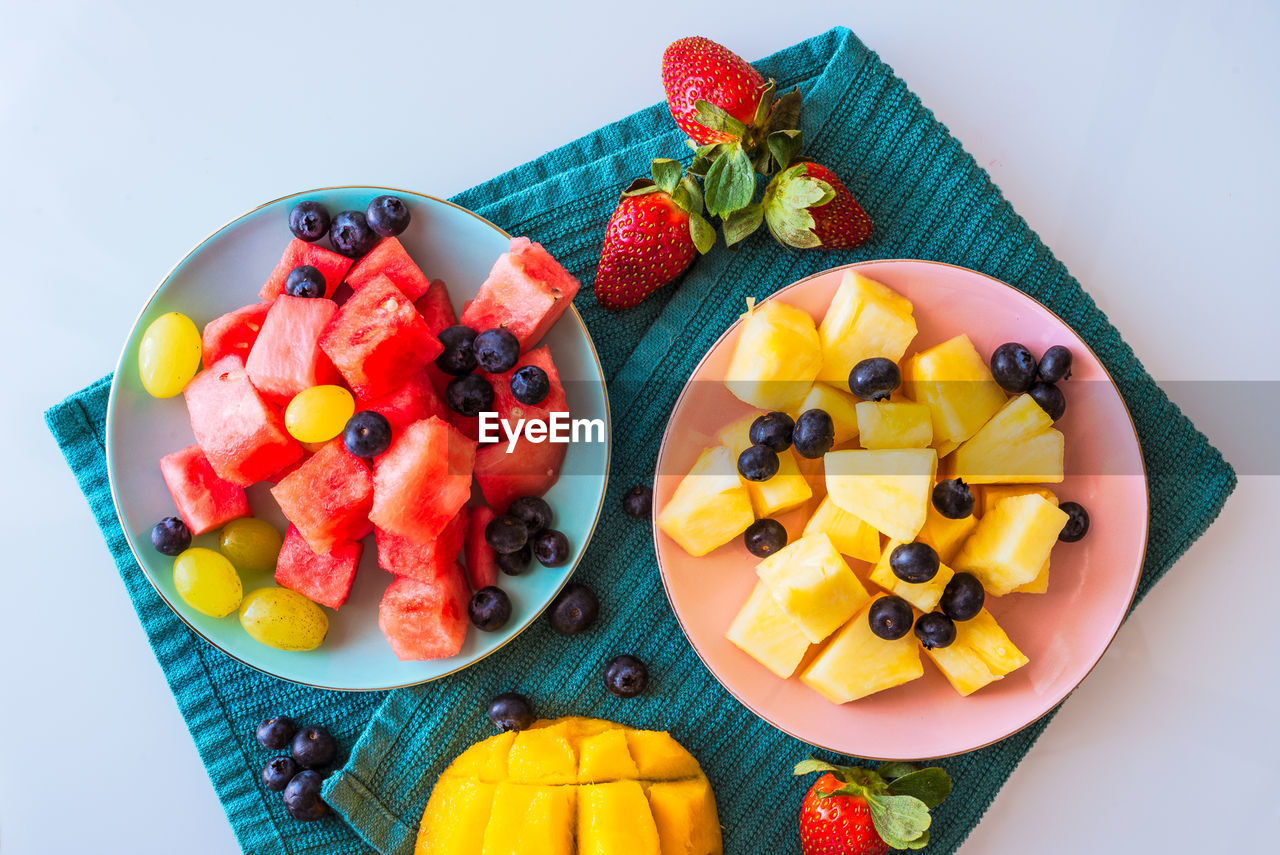 fruit, food and drink, food, healthy eating, freshness, berry fruit, still life, indoors, plate, high angle view, wellbeing, ready-to-eat, watermelon, slice, indulgence, sweet food, variation, blueberry, orange, choice, no people, temptation, fruit salad, breakfast, chopped