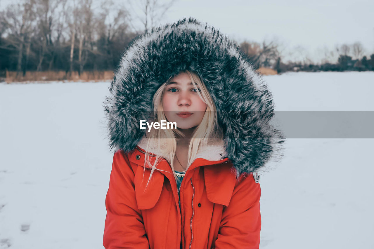 Young Woman In Snow Covered Landscape