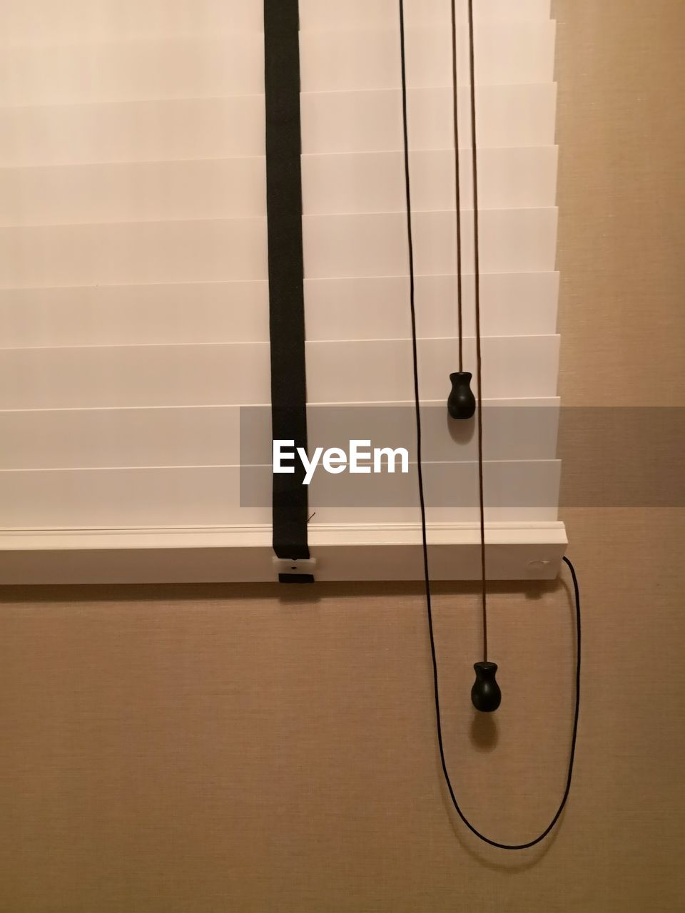 CLOSE-UP OF ELECTRIC LAMP HANGING ON CEILING