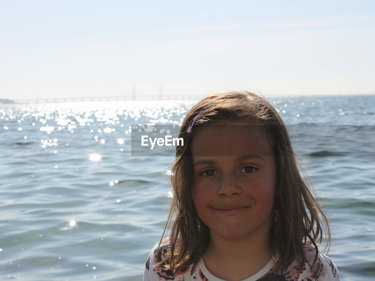 Portrait Of Smiling Girl Against Sea