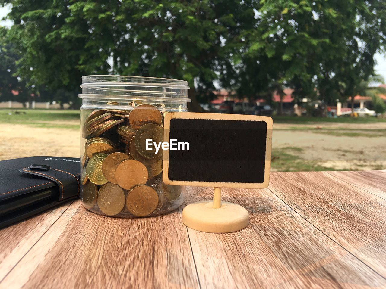 table, focus on foreground, coin, no people, close-up, tree, day, outdoors