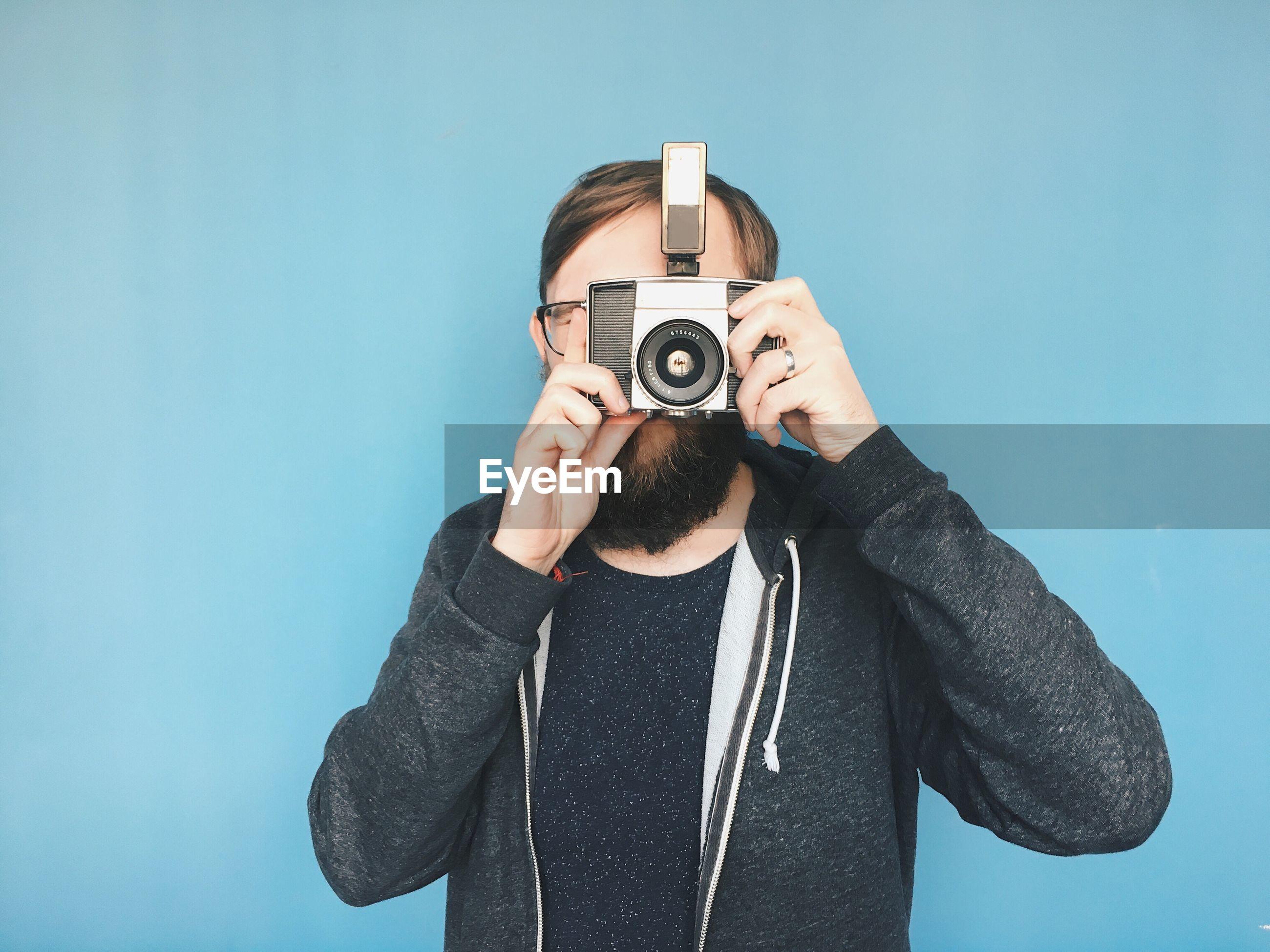 Portrait of man taking photographs