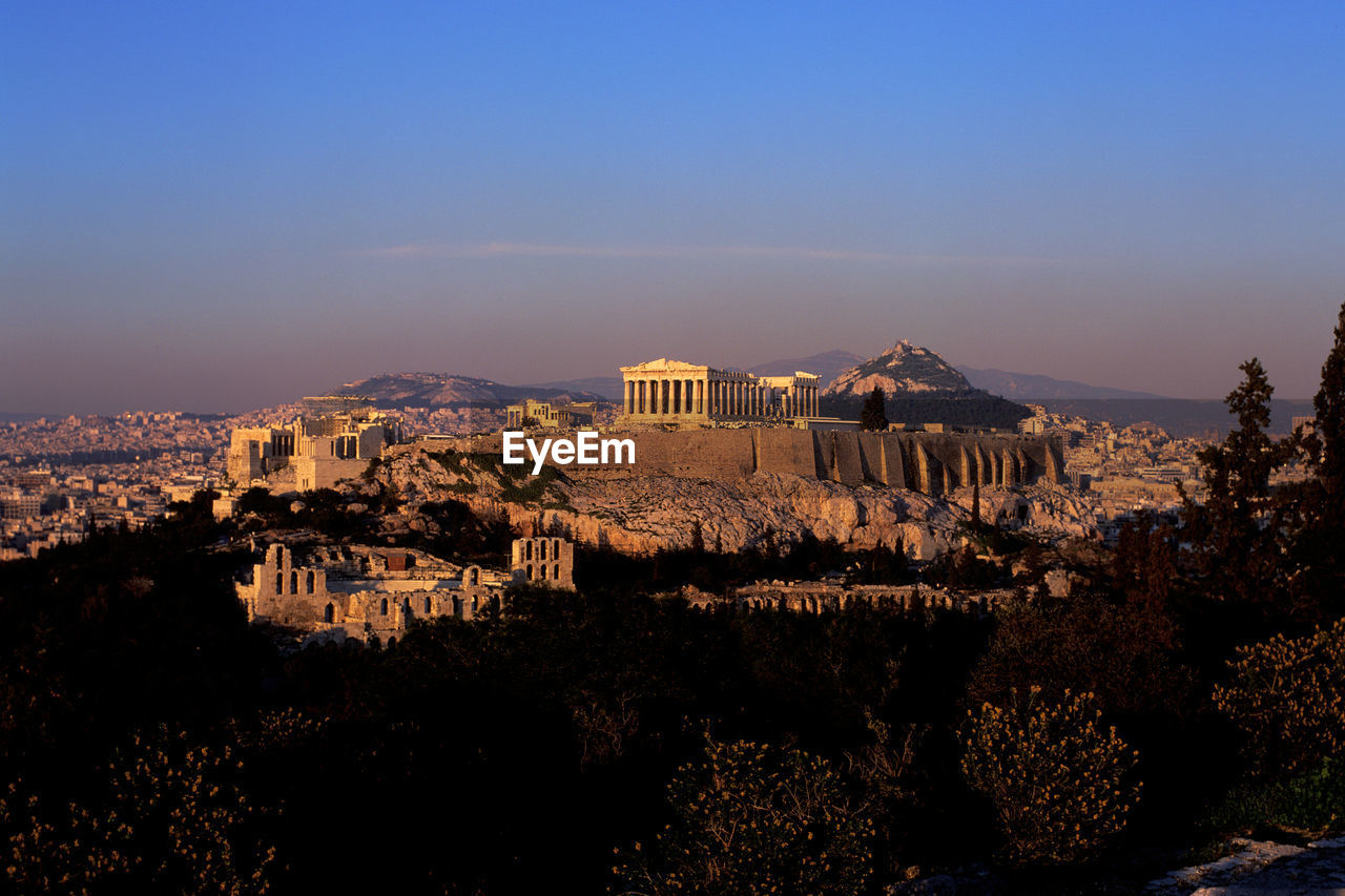 Residential District And Acropolis Against Sky At Dusk