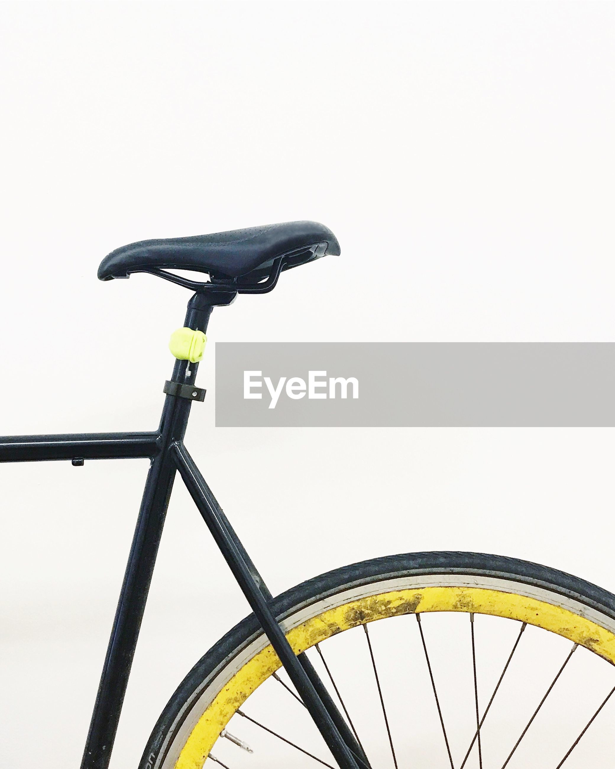 LOW ANGLE VIEW OF WOMAN RIDING BICYCLE AGAINST SKY