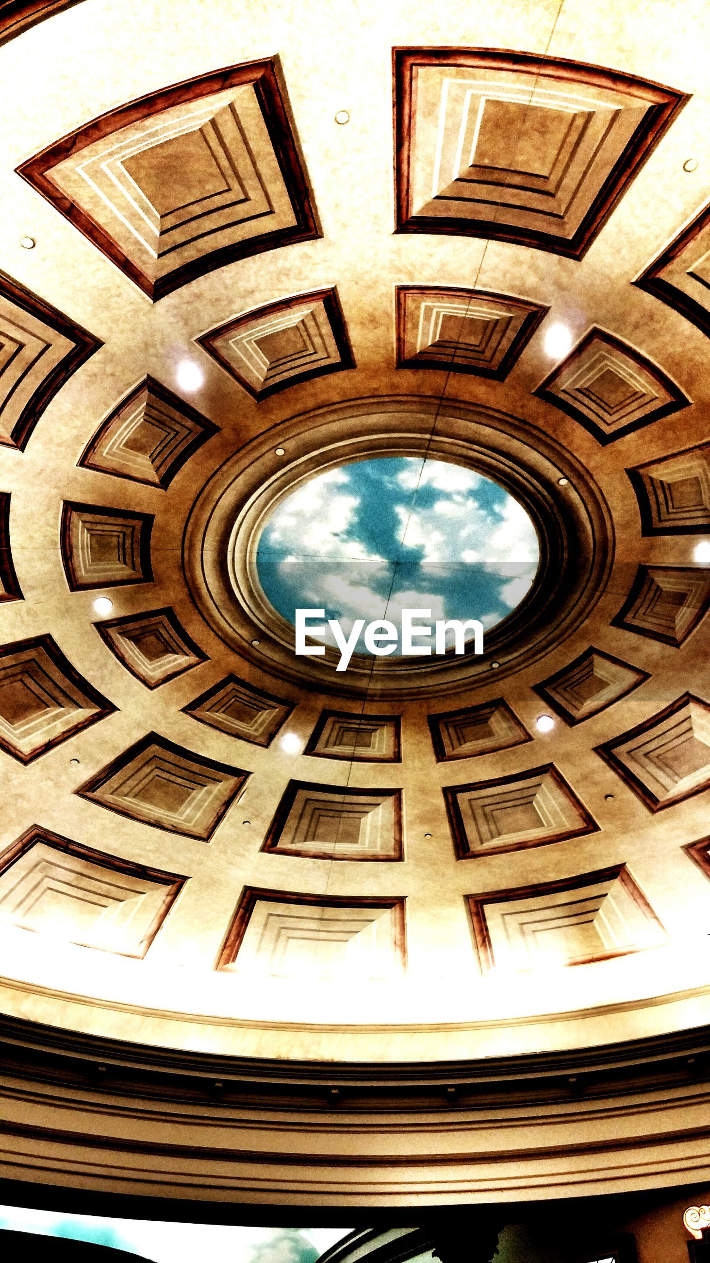 architecture, built structure, low angle view, indoors, building exterior, sky, directly below, circle, architectural feature, design, ceiling, pattern, arch, dome, window, place of worship, day, religion, geometric shape, ornate