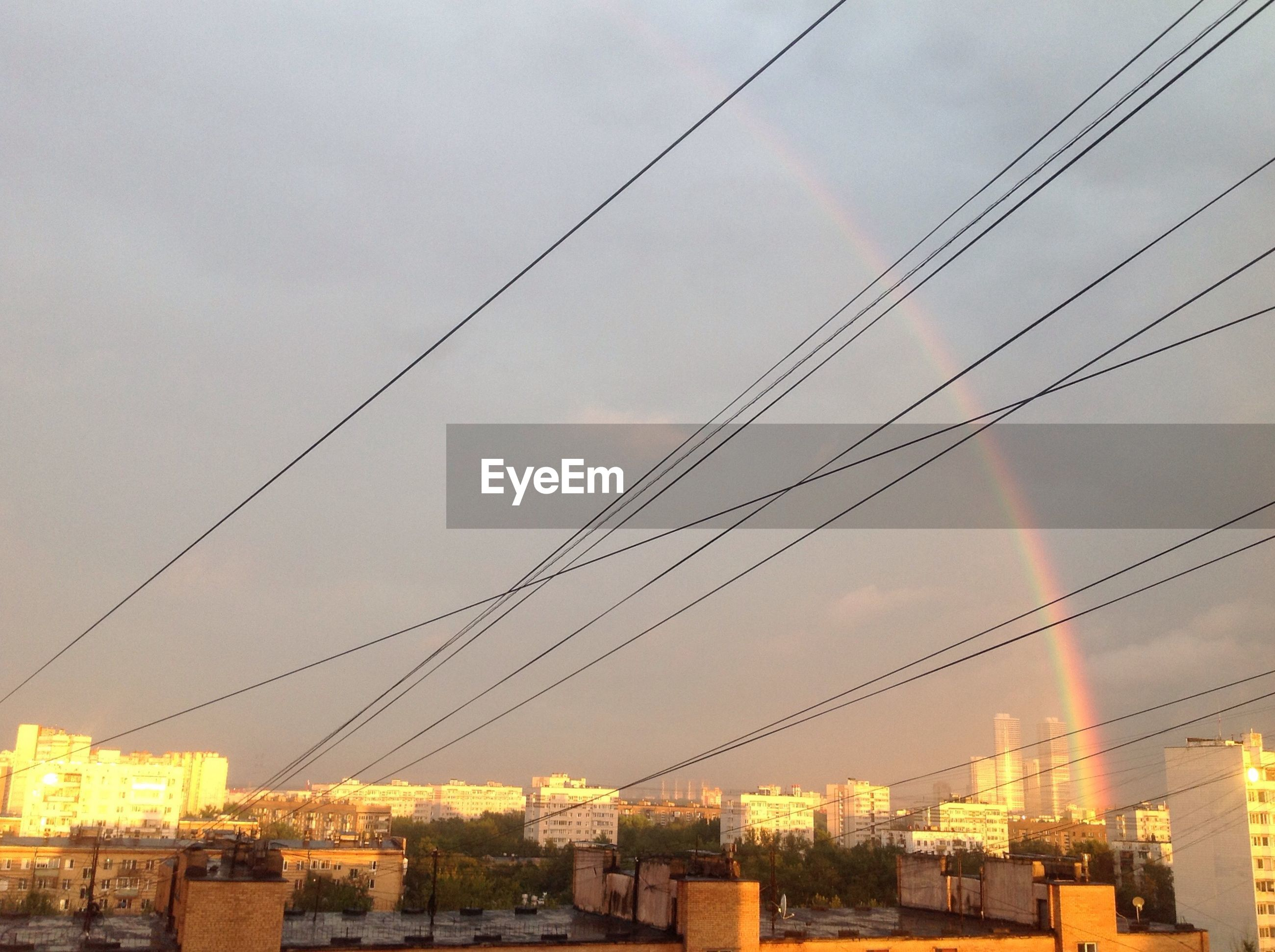 architecture, built structure, building exterior, city, power line, connection, cityscape, residential building, cable, power supply, engineering, sky, electricity pylon, residential district, city life, power cable, tall - high, urban skyline, skyline, day, development, wide, cable-stayed bridge, outdoors
