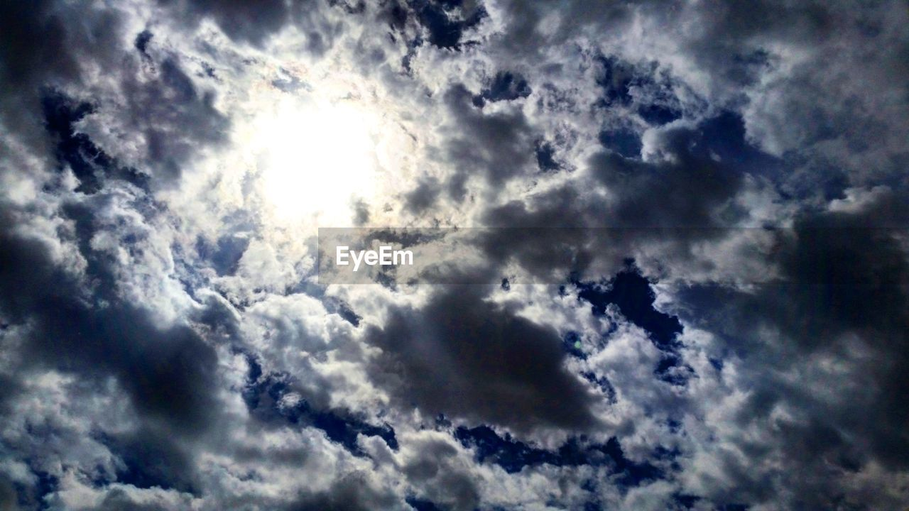 nature, low angle view, beauty in nature, backgrounds, sky only, weather, cloudscape, cloud - sky, scenics, sky, majestic, meteorology, awe, dramatic sky, tranquility, atmospheric mood, no people, full frame, idyllic, outdoors, heaven, environment, day, blue, storm cloud