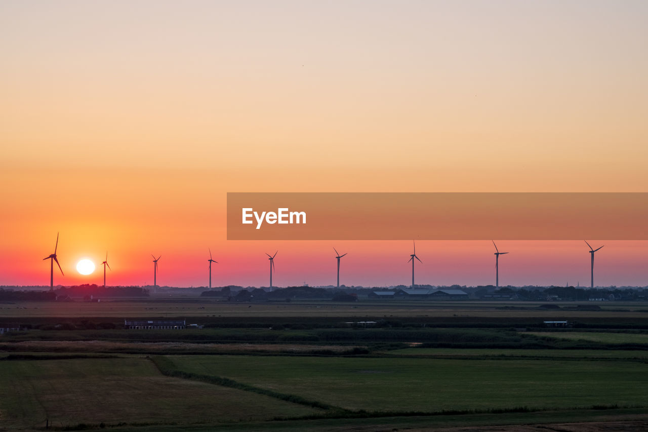 sunset, renewable energy, environment, wind turbine, turbine, sky, alternative energy, fuel and power generation, wind power, orange color, scenics - nature, beauty in nature, environmental conservation, technology, landscape, field, tranquil scene, tranquility, land, nature, no people, sun, electricity, outdoors, sustainable resources, power supply