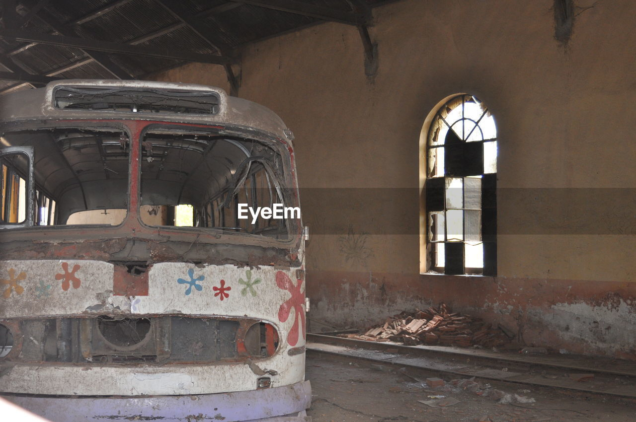 abandoned, old, damaged, obsolete, no people, mode of transportation, transportation, metal, architecture, window, day, run-down, land vehicle, rusty, rail transportation, indoors, deterioration, decline, ruined