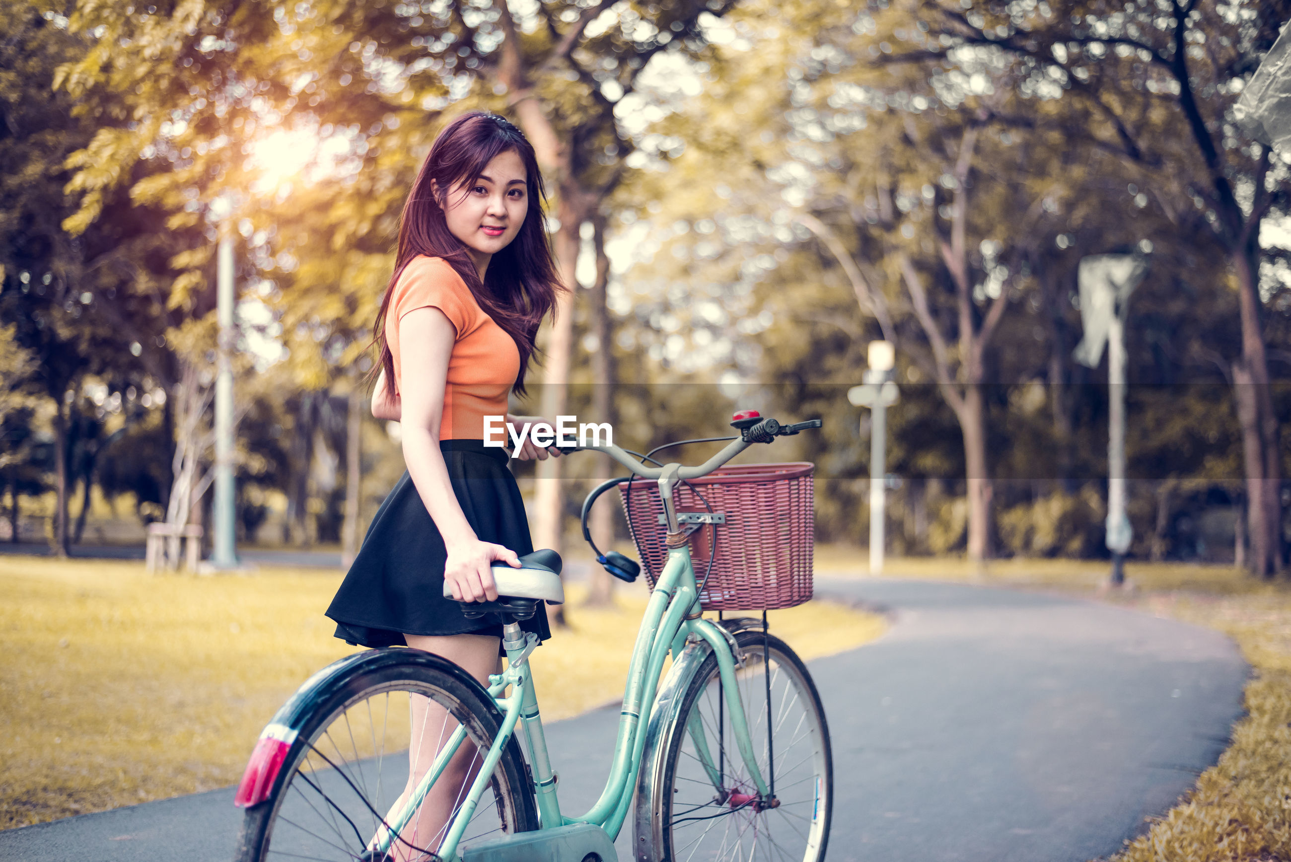 Portrait of woman riding bicycle in park