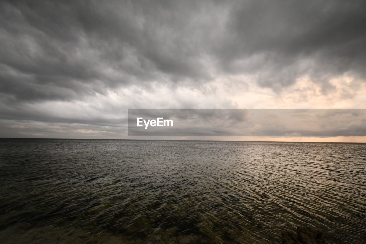 cloud - sky, sky, water, sea, scenics - nature, beauty in nature, horizon, tranquility, tranquil scene, horizon over water, overcast, nature, no people, idyllic, non-urban scene, storm, waterfront, land, ominous