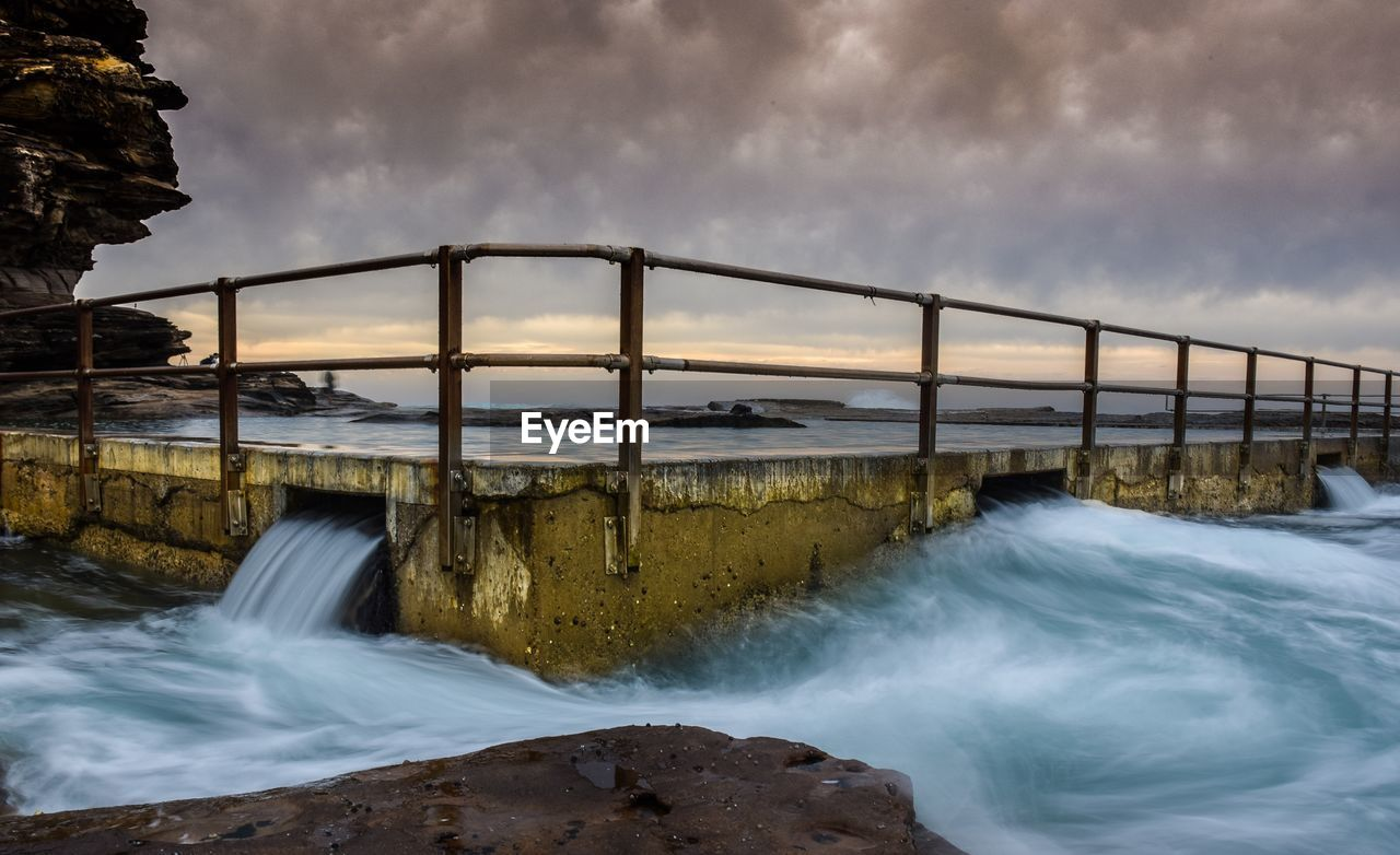 water, cloud - sky, sky, sea, motion, long exposure, scenics - nature, beauty in nature, nature, bridge, blurred motion, rock, no people, built structure, architecture, bridge - man made structure, connection, flowing water, rock - object, outdoors, power in nature, flowing