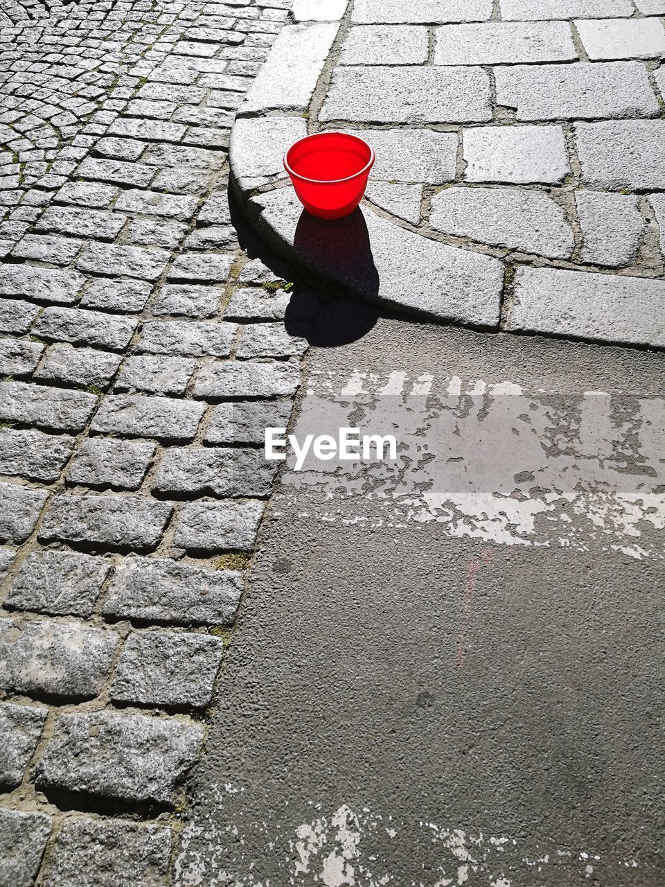 High angle view of bucket on street during sunny day