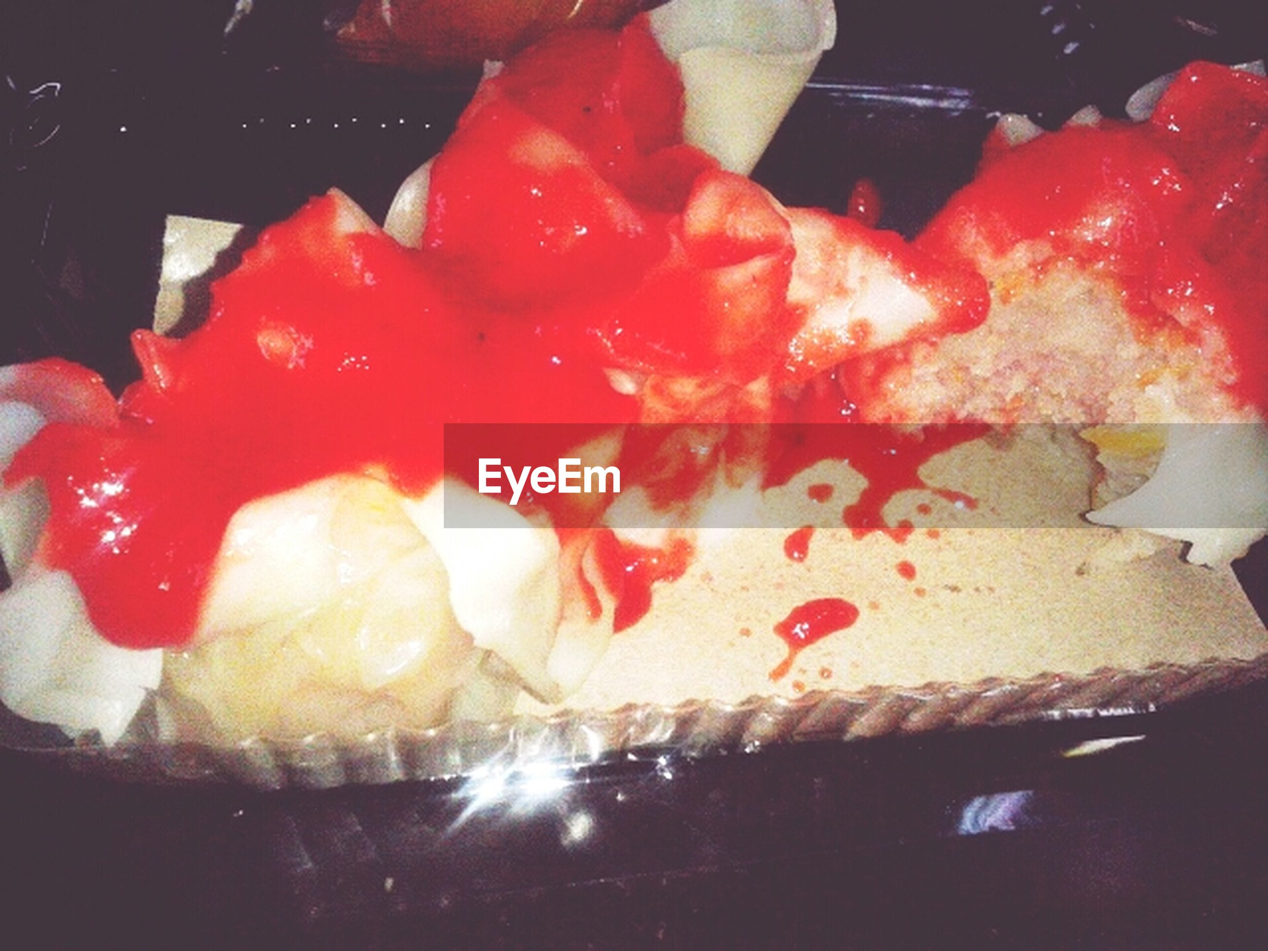 indoors, food, food and drink, freshness, sweet food, close-up, red, indulgence, still life, unhealthy eating, dessert, ready-to-eat, temptation, cake, high angle view, no people, slice, night, strawberry, preparation
