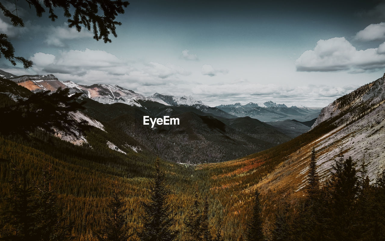 mountain, scenics - nature, sky, beauty in nature, mountain range, cloud - sky, tranquil scene, tranquility, environment, non-urban scene, snow, cold temperature, winter, landscape, nature, plant, no people, idyllic, snowcapped mountain, outdoors, mountain peak