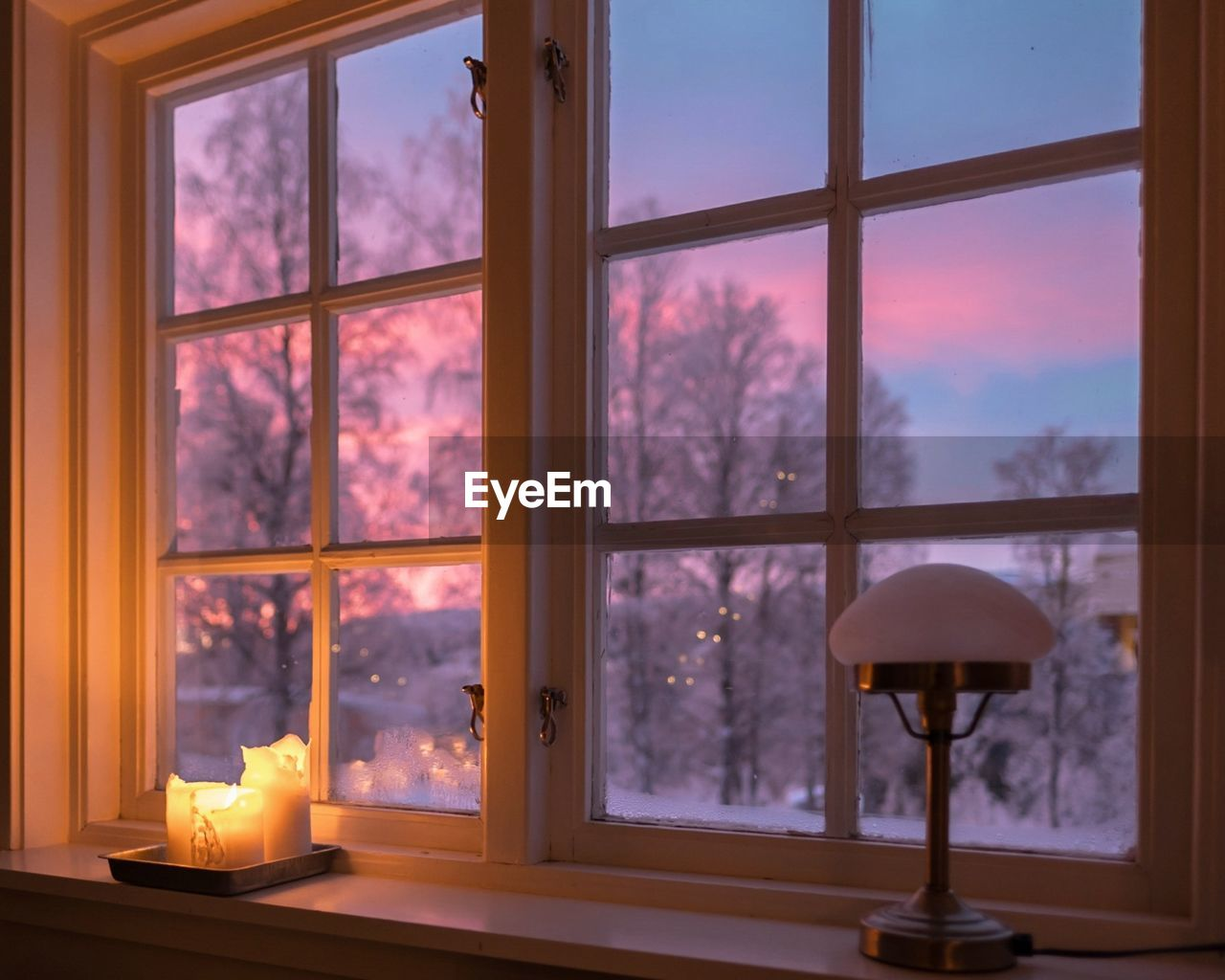 window, indoors, transparent, glass - material, no people, nature, flame, home interior, fire, candle, plant, burning, lighting equipment, illuminated, fire - natural phenomenon, tree, architecture, heat - temperature, sunset, electric lamp