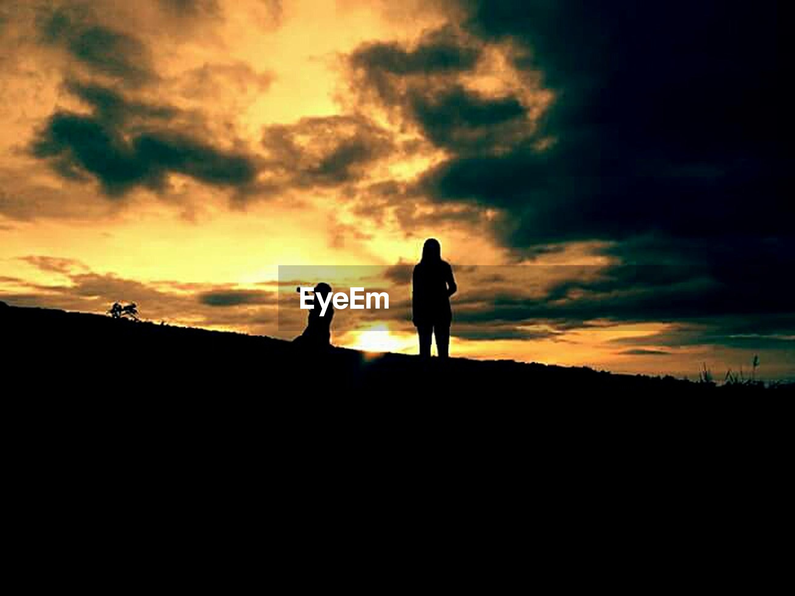 silhouette, sunset, sky, cloud - sky, togetherness, men, standing, lifestyles, orange color, leisure activity, outline, beauty in nature, scenics, nature, cloud, tranquility, tranquil scene, cloudy