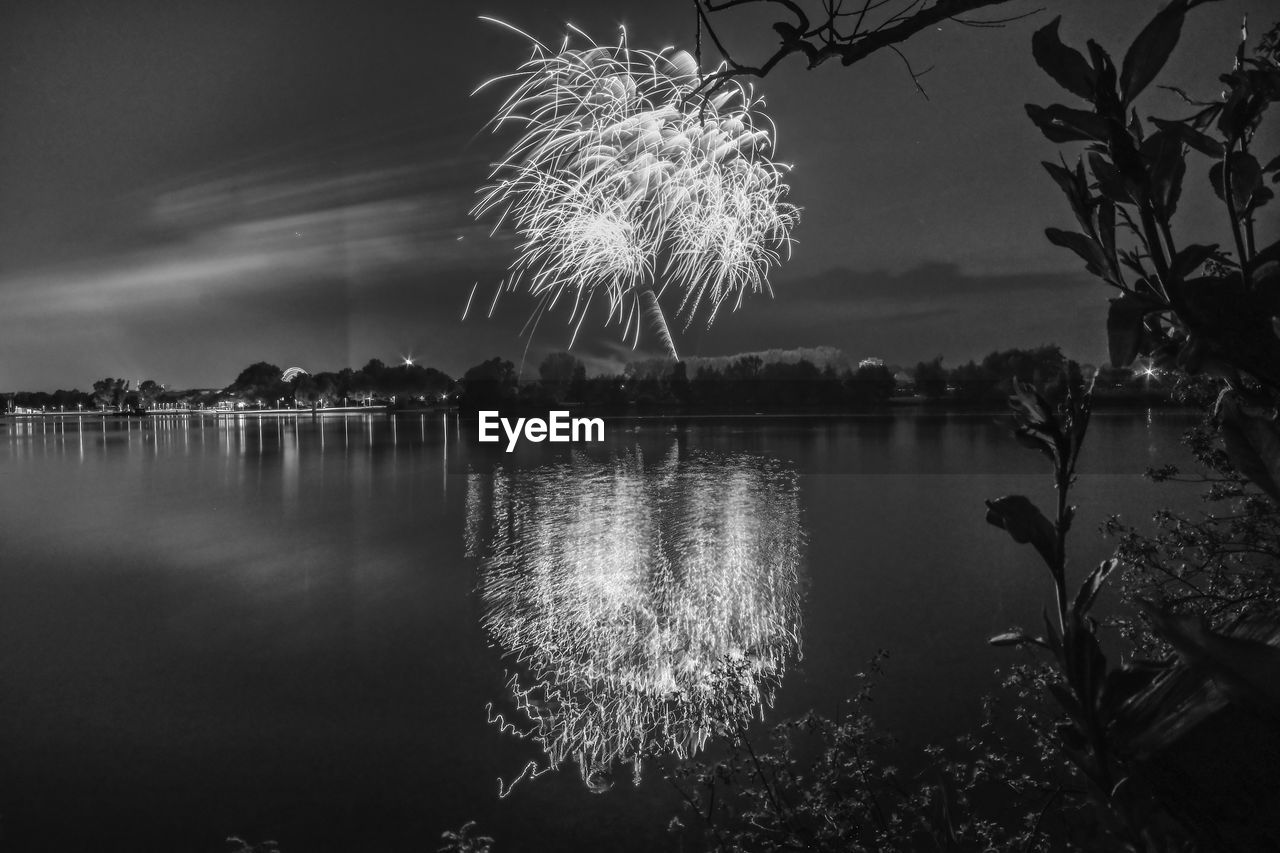 water, reflection, sky, nature, lake, plant, tree, illuminated, no people, night, tranquility, firework, outdoors, beauty in nature, tranquil scene, long exposure, scenics - nature, architecture, built structure, firework display