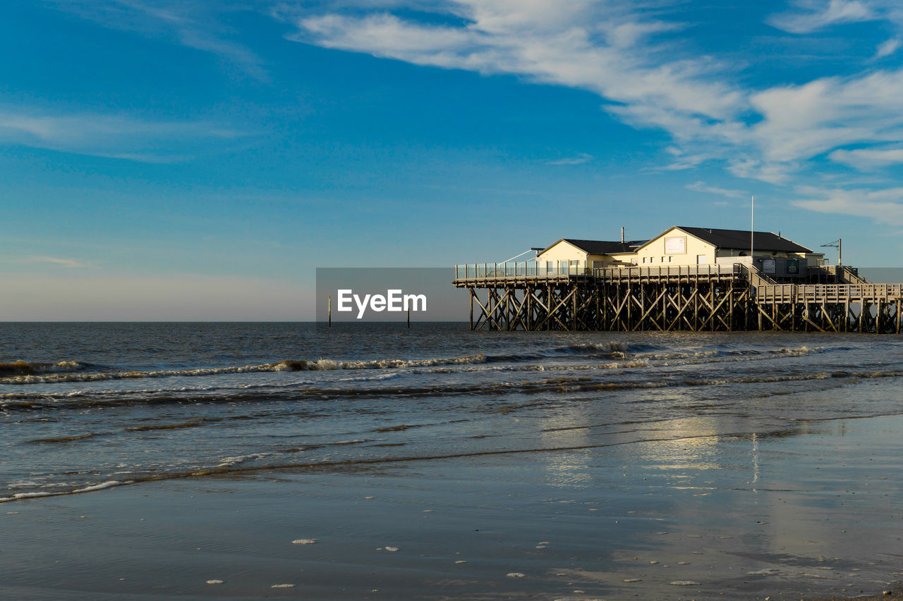 water, sky, sea, beach, built structure, architecture, land, horizon, horizon over water, cloud - sky, scenics - nature, building exterior, beauty in nature, nature, no people, motion, house, tranquility, building, outdoors
