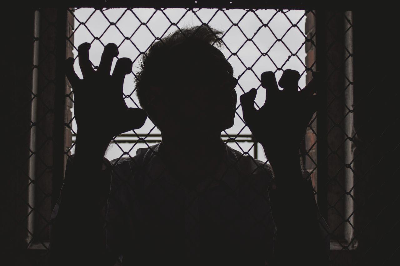 Silhouette Of A Captive Person