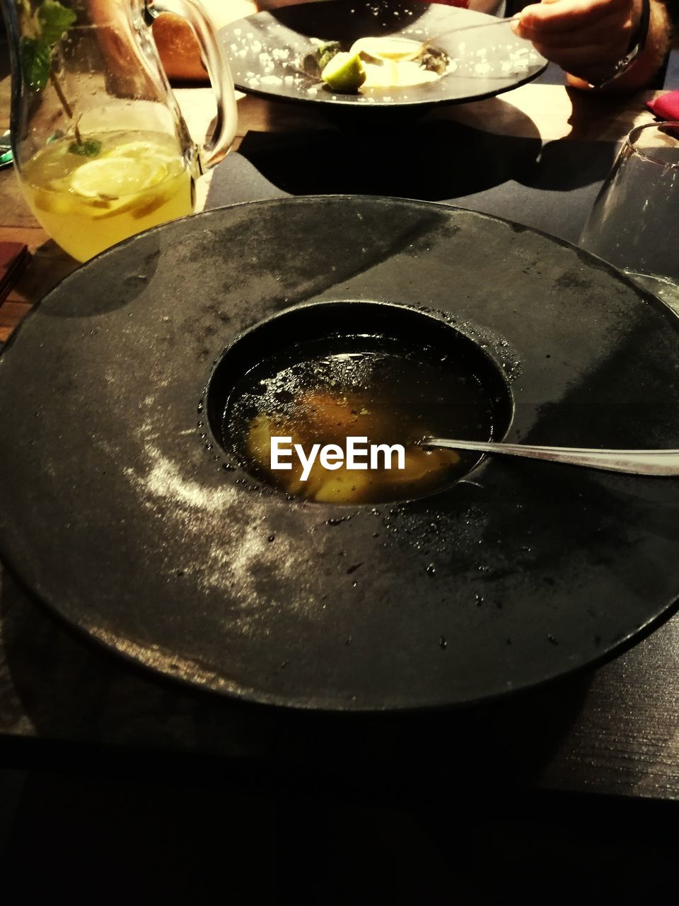 food and drink, food, freshness, kitchen utensil, preparation, household equipment, healthy eating, indoors, preparing food, wellbeing, human hand, close-up, oil, hand, high angle view, cooking oil, human body part, pan, ready-to-eat, meal, frying pan