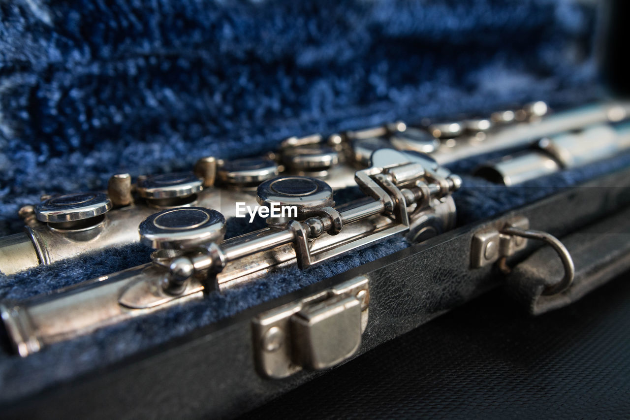 Close-Up Of Musical Instrument In Blue Container