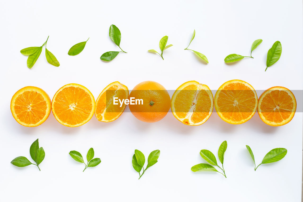 citrus fruit, food, food and drink, healthy eating, fruit, leaf, orange, orange color, wellbeing, white background, plant part, freshness, orange - fruit, studio shot, still life, green color, indoors, no people, slice, arrangement, herb, ripe, leaves