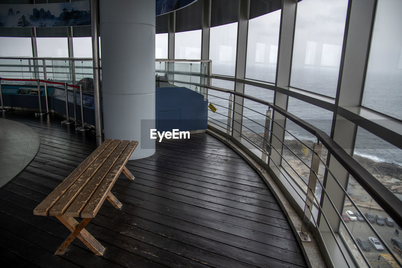 water, railing, sea, architecture, sky, built structure, no people, nature, day, indoors, seat, transportation, pier, window, ship, absence, empty, metal, cruise ship, passenger craft