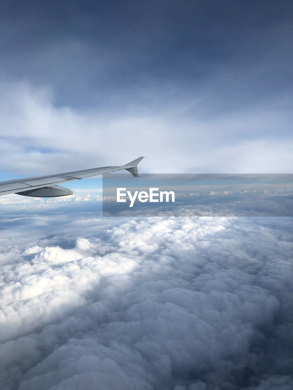 cloud - sky, airplane, sky, air vehicle, flying, mode of transportation, scenics - nature, beauty in nature, transportation, aircraft wing, cloudscape, no people, mid-air, travel, nature, day, motion, aerial view, on the move, outdoors, softness, above, meteorology, plane