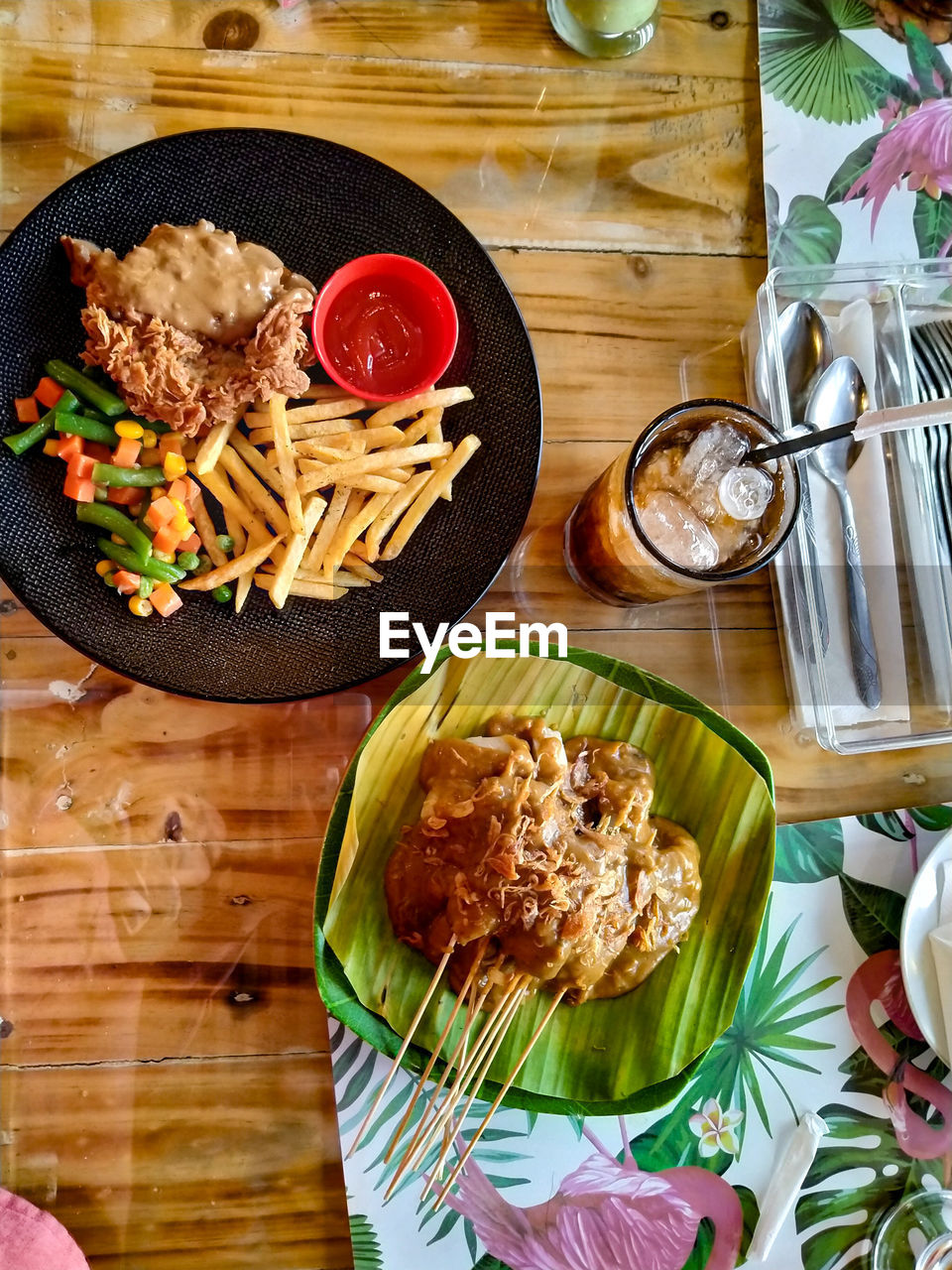 HIGH ANGLE VIEW OF FOOD SERVED WITH TABLE