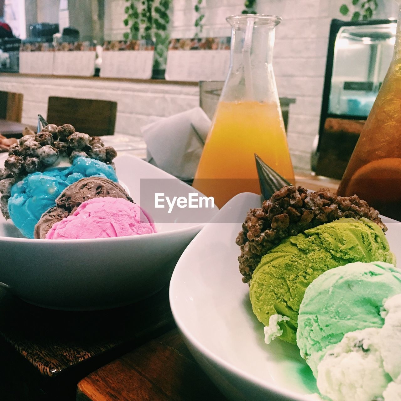 Ice cream in bowls on table