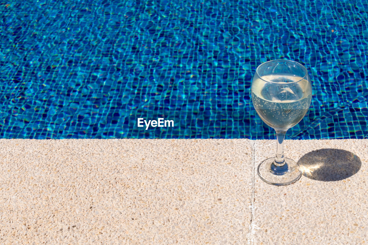 View Of Wineglass By Swimming Pool
