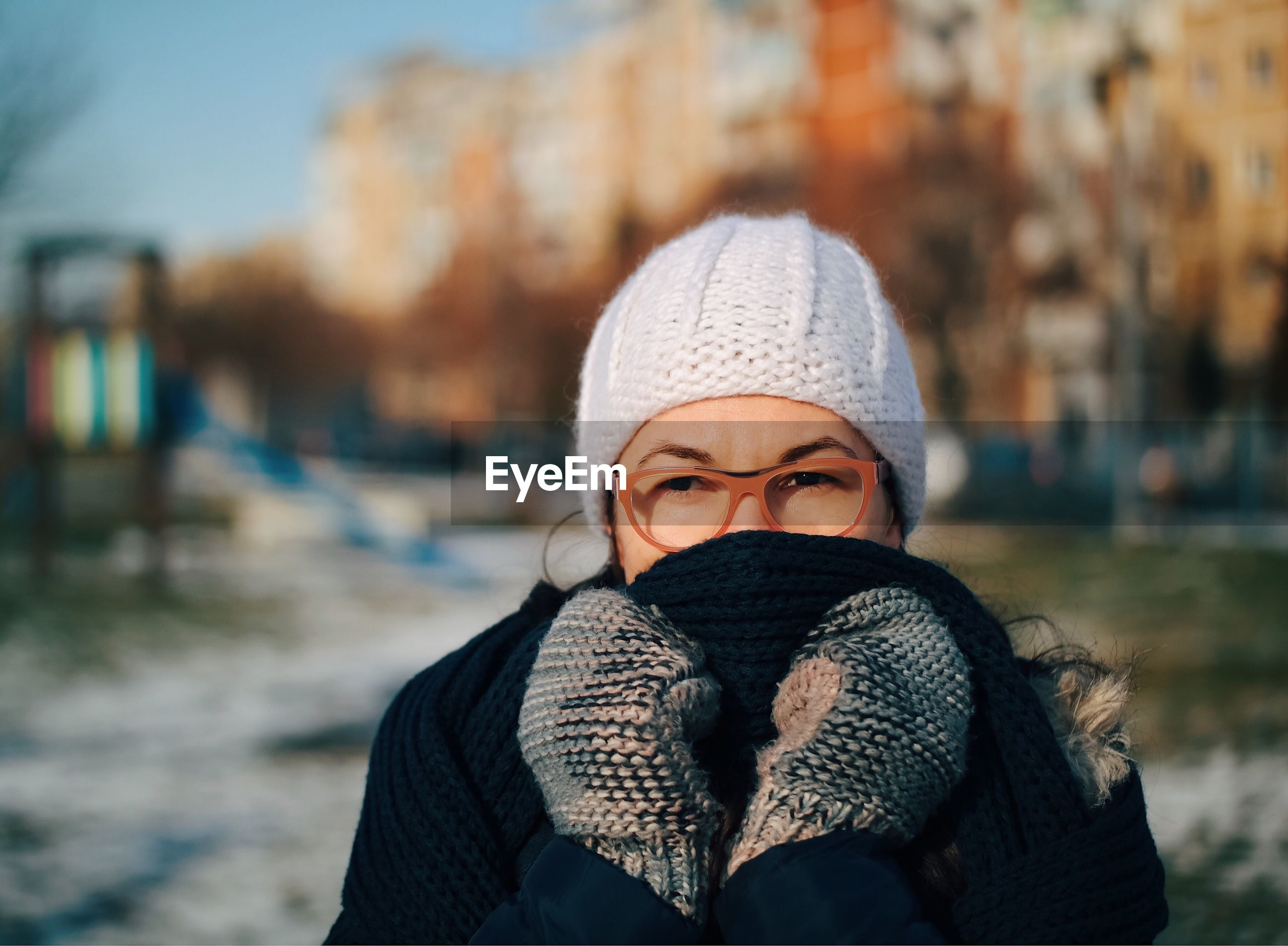 Close-up portrait of a woman in winter
