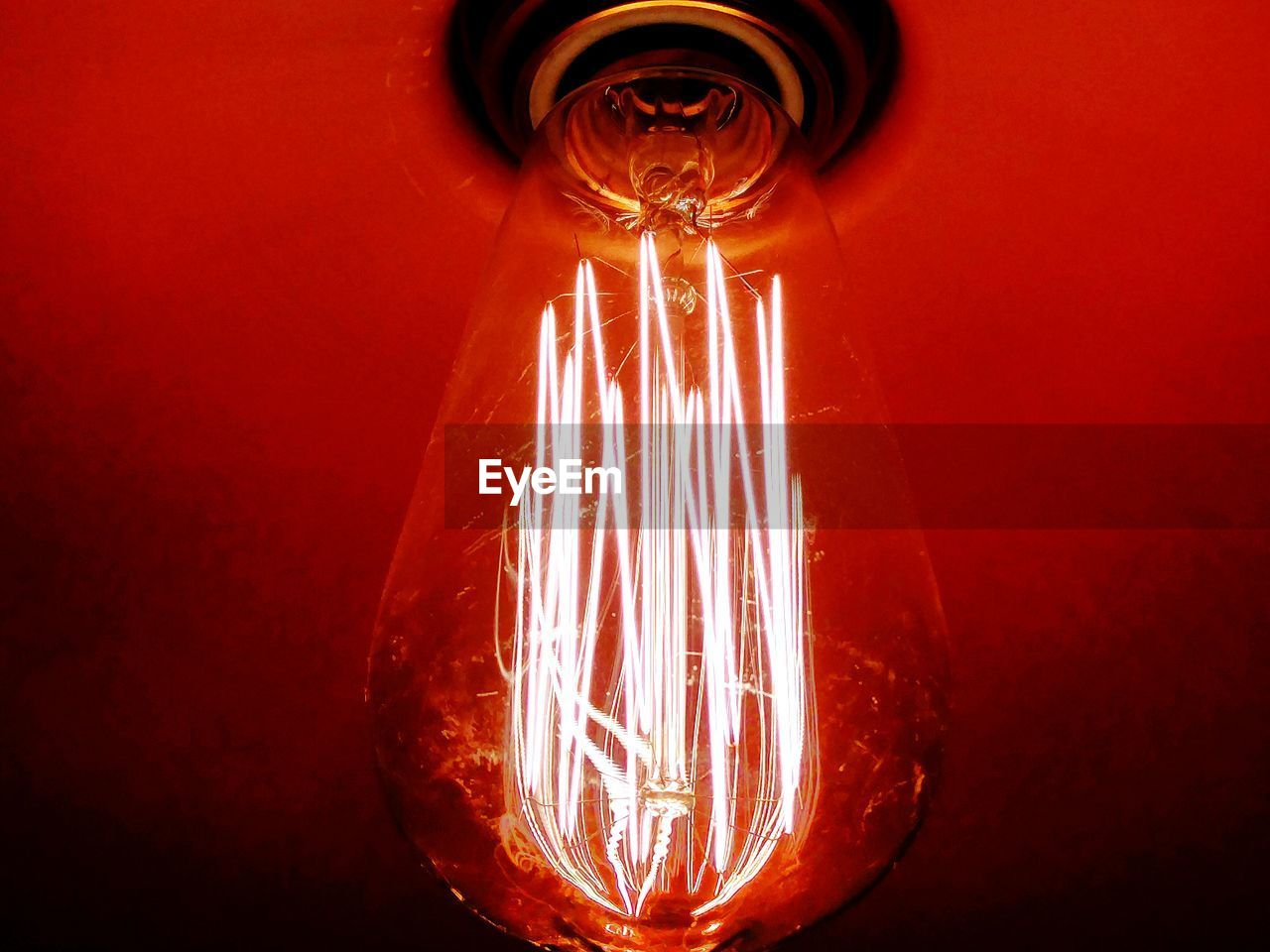illuminated, electricity, lighting equipment, light bulb, glowing, no people, filament, close-up, low angle view, indoors, technology, day