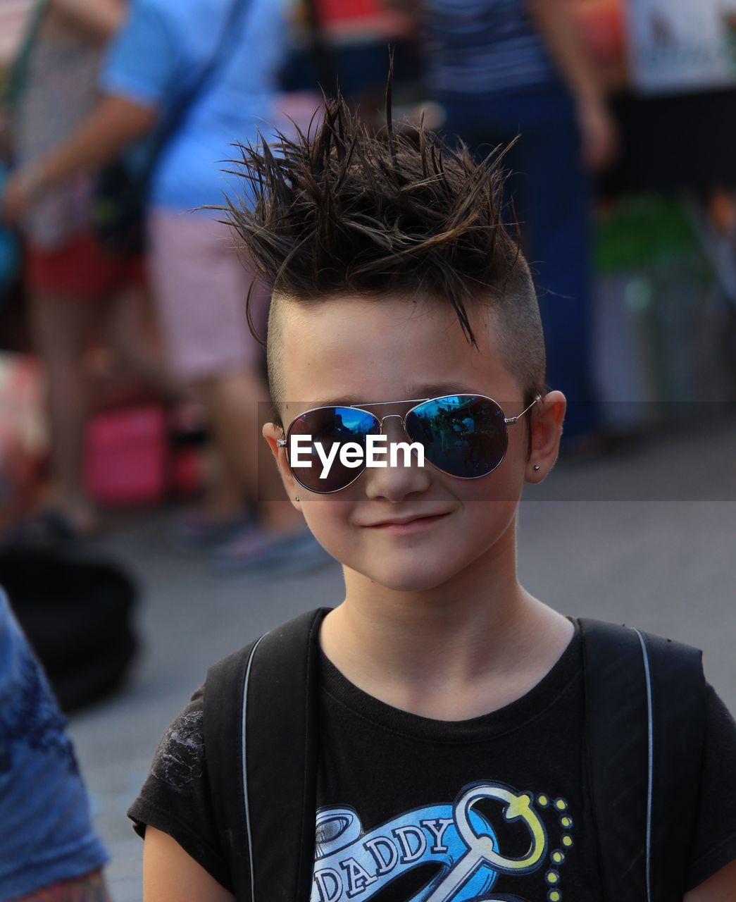 focus on foreground, real people, childhood, sunglasses, boys, front view, lifestyles, one person, looking at camera, leisure activity, portrait, outdoors, day, close-up